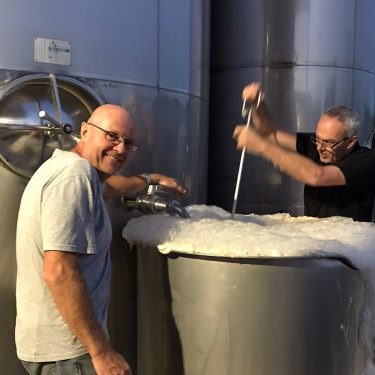 Kevin and brother Steve getting a Sauvignon Blanc fermentation going
